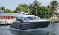 Stunning 2011 Sessa C54 Express powered by twin Volvo 900 IPS Diesels with Joystick control, give this vessel a Top Speed of 35 knots and Cruises comfortably at 30 knots.3 Stateroom Layout with Full beam Master. Retractable Hardtop and Hydraulic swim