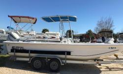 Beautifully well maintained example of a Carolina Skiff w/ a powerful 130Hp Evinrude w/ 220 Hours! Features include: -T-top -Dragonfly Fishfinder -Helm Seat with room for a cooler beneath -Livewell -Console seat forward with lockable storage-5 Rocket