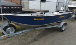 2012 Duroboat 14LW This boat package includes easy launch wheels, full boat cover, floor, 2 fuel tanks, 2 seats, rodholders, a fourstroke Honda 15hp outboard w/power tilt & electric start and a galvanized EZ Loader trailer w/spare tire. This boat is very