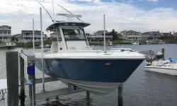 This 2012 290CC Everglades is super clean and lift kept. The owners are moving up to a larger Everglades and have priced this boat for a quick Summer sale. She is equipped with twin 300HP Four Stroke Yamahas that have warranties until May 2017. Owners