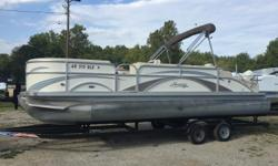 2012 Hampton 2485 Rear Lounger power by an Evinrude 175hp outboard Beautiful boat, ordered and sold here new in 2012. 226 engine hours. Trailer not included in price Beam: 8 ft. 5 in. Depth fish finder; Boat cover; Stereo; Bimini top;