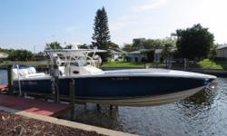 New listing to the market.Very clean one owner 390 Sport with the upgraded fishing package which includes live-well and rod holders.Well maintained and priced for quick sale.  Triple Mercury Verado 300s, Livorsi DTS Throttles, Smart