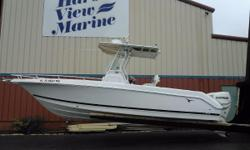 This 26 SuperSport has a fiberglass hard top and 4G Radar. There is a single large color display for the Lowrance Radar, Fish Finder and GPS. It has a vhf radio, compass and trim tabs. Its powered by twin Evinrude Etec 150s that show 264 hours. A few