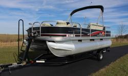 2012 Suntracker Bass Buggy 18 DLX 20' Black with beige carpet and Vinyl floor covering. Includes 3 fishing seats, front and rear aerated livewell, lowerance X-4 graph at helm station, stereo with MP3, Wireless 12 volt powerdrive Trolling motor, bimini top