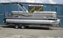 2012 Sweetwater 220 SL Premium Edition Yamaha 115 HP Fourstroke Electronic Fuel Injected outboard ** 25 inch diameter pontoons ** AM/FM/CD ** Docking lights ** Ski tow bar ** 4 step re-boarding ladder ** Pop-up changing room ** Cockpit table ** Bimini top