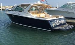 """A true """"Crown Jewel"""" of Tiara's line-up, this 3100 Coronet won't disappoint. Loaded with every conceivable option, it's stands in a league of its own. We'll start with a Flag Blue hull with High Gloss teak trim package. Upgraded features like 5.0 Kohler"""