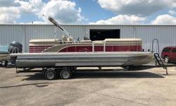 Boat Includes the Following Options:Bronze Accent PanelRaised Chrome LogosFull Vinyl Floor W/Snapin CarpetSeagrass AftExtended Aft Deck W/SeagrassTwin Eliptical TubesLifting Strakes And WavetamersHydraulic SteeringBow Gate SeatR Series ReclinersFish