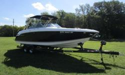 Black w/ Sandstone Boot Stripe Graphics, Volvo V8-380HP Fuel Injected Engine, 148 Hours, Dual Stainless Steel Prop Drive, Stainless Steel Arch w/ Bimini Top, Extended Swim Platform w/ Flip Down Swim Step, Walk-thru Transom, L-shaped Cockpit Seating w/
