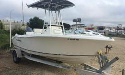 The 1900 XS has a roomy cockpit thanks to the fold down bench seat and the location of the baitwell outside of the cockpit. Owner states that the boat has less than 100 hours on her. She has a Cobra VHF radio, a Lowrance Elite5 GPS/fishfinder