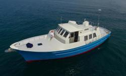 "Here's a unique opportunity to own a custom built award-winning  Steve Seaton designed Trawler.  Years in the making but less than 75 hours the renowned Yacht builder describes this 53' as a ""Small Ship"".  With a"
