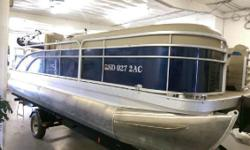 2014 Bennington 22 SSX Cruise and Fish pontoon in Regatta Blue with Java interior. 70 HP Yamaha four stroke, cruise front with 2 fishing chairs surrounding a fish station with livewell in the rear. Also includes full color matched playpen cover, 10'