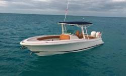 Fantastic example of the 29 Catalina Heritage edition. Kept as a tender for a larger yacht, this boat is in great shape and has a very classic look with the teak package and diamond stitch tan upholstery. It is perfectly placed cruising around or docked