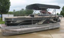 Mercury 90 hp 4 stroke EFI Nice luxury pontoon with powered remote controlled bimini / cover. Comes with am fm blue tooth radio, fish / depth finder, rear table, rear swim ladder, tow bar and premium poly vinyl flooring. Nominal Length: 23' Stock number: