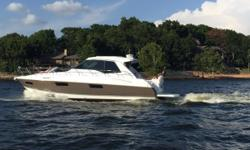 Lowest Priced on the Market: Reduced to $599,000 This 48' Cruisers Cantius 2014 is a freshwater boat that has been kept undercover in a boathouse since new. She has an optional wood interior and integrated spacious double salons with a 2 stateroom/2 head