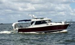 """Going Coastal"" is in Fantastic Condition with every available option! Super Clean Inside and Out! She is Ready to Take you to All Your Dream Destinations!! Beautiful Claret Red Hull Shines Like New Bottom Painted January 2018 Lift Kept Volvo Penta D-6"