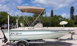 2014 Key Largo 168 Bay, Located in Nokomis, FL. Call Coastal Marine for more information. Like new stored indoors with 60 HP 4 stroke Suzuki motor with Factory warranty, 4 blade stainless prop, live bait well, rocket launchers, bimini, dol fin, fuel water