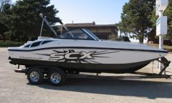 New 2014 Starcraft 210 SCX with Mercruiser 5.0 MPI and EZ Loader custom tandem trailer. Options include LS pkg (snap in carpet, lighted cup holders/speakers, upgraded stereo, amp, 2 rear facing speakers, remote touch pad, transom shower, underwater
