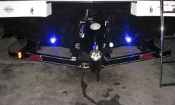 New Starcraft 210 SCX with Mercruiser 5.0 MPI and EZ Loader custom tandem trailer. Options include LS pkg (snap in carpet, lighted cup holders/speakers, upgraded stereo, amp, 2 rear facing speakers, remote touch pad, transom shower, underwater lighting),