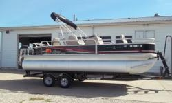 2014 Sun Tracker Fishin Barge 22 Delux equipped with Mercury 90 hp 4 stroke outboard motor and Motor Guide 12 V trolling motor with 55 lbs. thrust. Boat includes bimini top, wind guides, table, rear ladder, cover, livewell, Lowrance X-4 @ dash, radio,