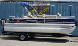 2014 Sun Tracker Fishing Barge 20 DLX*Mercury 60 HP 4 stroke outboard with power tilt/trim*AM/FM/AUX/Bluetooth capable/12 Volt Input*Bimini top with drop down privacy curtain*Cockpit table*Vinyl