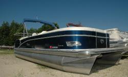 NEW Winter Price ONLY $21,695! This beautiful, versatile, Deco-inspired craft is the ultimate pontoon boat for lounging, tubing, and swimming. Find the sun from any angle on the comfortable fore and aft facing lounge arms. Has a large rear swim platform