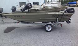 """The all-welded TRACKER® GRIZZLY® 1448 is perfect for outdoorsmen who want a rugged, no-frills Jon boat that can fish and hunt. Its 16"""" (40.64 cm) all-aluminum transom is designed to accommodate a tiller engine for easy control. This also leaves the"""