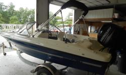 THIS PRISTINE UNIT SPORTS THE MERCURY 60HP FOUR STROKE FOR LIGHT TUBING AND SKI POWER, FACTORY TRAILER, BIMINI TOP, COVERS, AND GUAGES, SWIM LADDER, $350 OF FREE WARRANTY COVERAGE FOR 30 DAYS NO CHARGE!