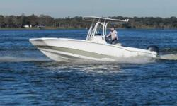 2015 NauticStar 231 Coastal Bay Boat with a four stroke Yamaha 200 HP and tandem axle Magic Tilt trailer. It's equipped with a white powder coated T-Top, deluxe lean post, swim platform, infinity stereo system, dual battery switch, and the bow back
