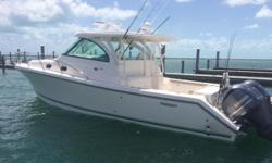 Owner motivated! She's just been detailed and received new bottom paint!   Cleanest OS 385 on the market! Call today, owner wants her sold!! Boat was custom ordered, and was delivered new in May of 2015. Her extensive options list includes: -