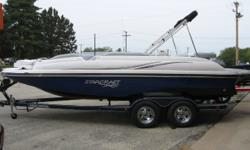 New 2015 Starcraft 220 Starstep with Mercruiser 5.0 MPI and custom EZ Loader trailer. Options include Sportstar package (two tone hull/deck stripe, grey LS interior, black LS dash, SS rail, LED cupholders/speakers, depth, hour meter, snap in carpet, swim