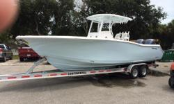"""If you are looking for a fantastic fishing platform or just a family fun boat, this beautiful Ice Blue 2015 Tidewater Custom 280 CC is for you! Twin Yamaha 250 XCAs with low hours and under warranty, a """"T"""" Top, Taco Outriggers, and all the electronics you"""