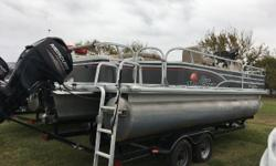 2015 SunTracker Fishin Barge 22. Powered By a 2015 60HP Mercury Motor. In great condition. Comes with a Lowrance Hook 7 Depth Finder Nominal Length: 22' Length Overall: 1' Engine(s): Fuel Type: Other Engine Type: Outboard Beam: 1 ft. 0 in.