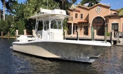This 2015 Yellowfin 26 is loaded to the gills with options. Designed to be an overall performer, fishing the shallows for redfish, trolling for tunas offshore or cruising in comfort Yellowfin hit a home run with the 26 hybrid. This boat can do it all with