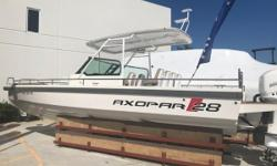 One owner, rack stored with only 165 hours and engine warranty till 3/2021.The Axopar T-Top is the ideal boat for water sports, sunbathing, diving or relaxing with family and friends. She features plenty of walk around space, a forward head with
