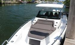 With an extended length roof when compared to the T-Top, the Sun-Top version offers the most shade and weather protection possible, by way of a manually controlled, full-length Sunbrella canvas section, which can be upgraded to full electric control as