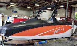 2016 Heyday WT-1 (Waketractor-1) with a 5.7L V-8 Crusader and trailer. Manufacturer options include accent package, deluxe textured flooring package, zero off GPS speed control, storage tray above motor, wide bucket helm seat, swivel board racks, deluxe