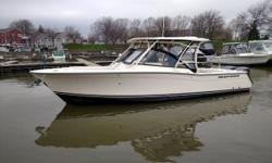An upscale day boat with fishing, cruising, watersports and entertaining capabilities - Grady-White's 307 Freedom is the perfect all around boat! Adjustable seating provides comfort for company and room for fishing off the aft deck. An enclosed head, hard