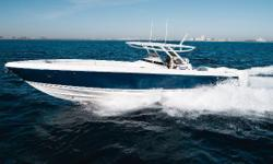 """""""WILDHARE"""" has a rideunlike any center console I've ever been on and must be experienced to be appreciated. She's been custom designed with performance in mind: the 100 gallon additional fuel tank and battery bank were moved into the bow to evenly"""