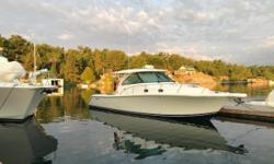Enjoy the views of Lake Erie and overnight at your favorite island on Pursuit's 385 Offshore! The cockpit is rigged and ready to fish with all of the amenities and includes a grill to cook the days catch. Sleeping for four is arranged below decks along