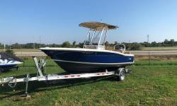 Certified Trade with Warranty - Scout's 195 Sportfish offers a vast space to move around freely and land the big catch of the day! This center console is great trailerable fun for the whole family! Aristo Blue Hull Color Powder Coated Ski Tow T-Top Bow