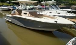 Enjoy some fun in the sun this summer on this Scout 255 LXF! There is ample space throughout the boat to move and storage. A fold out table forward and extra cooler space are ideal for entertaining or relaxing on the open water. Silver Anniversary