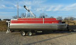 2016 Silver Wave 230 Island CC pontoon equipped with Mercury 90 hp 4 stroke outboard motor and Minn Kota Terrova 24V trolling motor with I-Pilot and 80 lbs. thrust. Boat includes bimini top, snap cover, wind guides, docking lights, rear ladder, livewell,