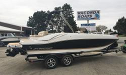 Mercruiser 4.5L (250hp), custom EZ Loader trailer, LS pkg (snap in carpet, lighted cup holders/speakers, upgraded stereo, amp, 2 rear facing speakers, remote touch pad, transom shower, underwater lighting), livewell, cockpit cover Hull color: