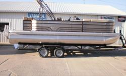 2016 Veranda Relax V2275 Pontoon boat on a Mid-America tandem axle trailer. We will be hanging a VF115LA Yamaha SHO four stroke engine on it. The boat is loaded with standard features and this one has upgrades that include Bronze panels, Powder coat