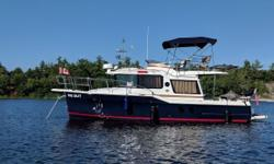 Beam: 10 ft. 0 in. Compass; Depth fish finder; Stove; Vhf radio; Stereo; Bimini top; Shore power; Gps loran; Radar; Fridge; Shower; Swim platform;