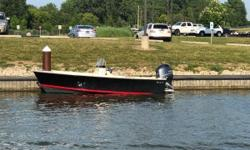 Runabout Lake Erie on this 17 foot center console Rossiter! There is enough room for a little bit of everything - time at the beach, fishing, island hopping, or just cruising the Lake. Black Hull Color 115hp Yamaha Barrier Coat & Bottom Paint