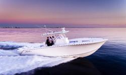 """$10k Price Reduction: This beautiful center console is hull #1 of SeaHunter's Tournament 33 model.The 11'4"""" beam and 900HP provides an impressively smooth ride for a 33' boat that can still be easily trailered. She cruises at"""