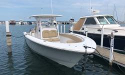 As close to new as possible and approximate 32 hours on the engines. This is a well-built ('NO WOOD') and impressively laid out center consoled. She is loaded with high end Simrad electronics and what every center console owner lines ' side entry door