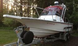 Great NW Sport fishing boat, Boston Whaler combines decades of experience in center consoles and trailerable boats. Original gelcoat finish under the waterlineCustom Galvanized Load Rite Tandem Trailer with 2 spare wheelsBoat comes with great electronics,