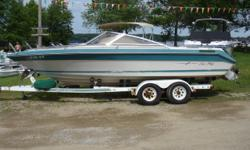 """This 23' Sea Ray """"Sorrento"""" has a V-8 MerCruiser, and a tandem axle, roller trailer with brakes. Includes a cd player, back to back seating, bow & cockpit cover, trailering cover. Interior in good shape and runs great! Beam: 7 ft. 10 in. Stock number: PA"""